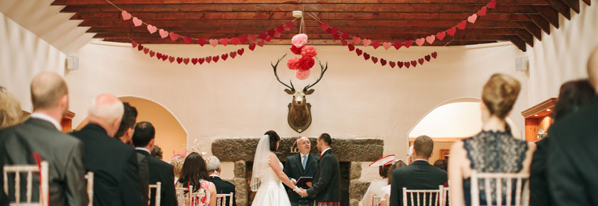 A Wedding Ceremony in the fireplace room at Aswanley.